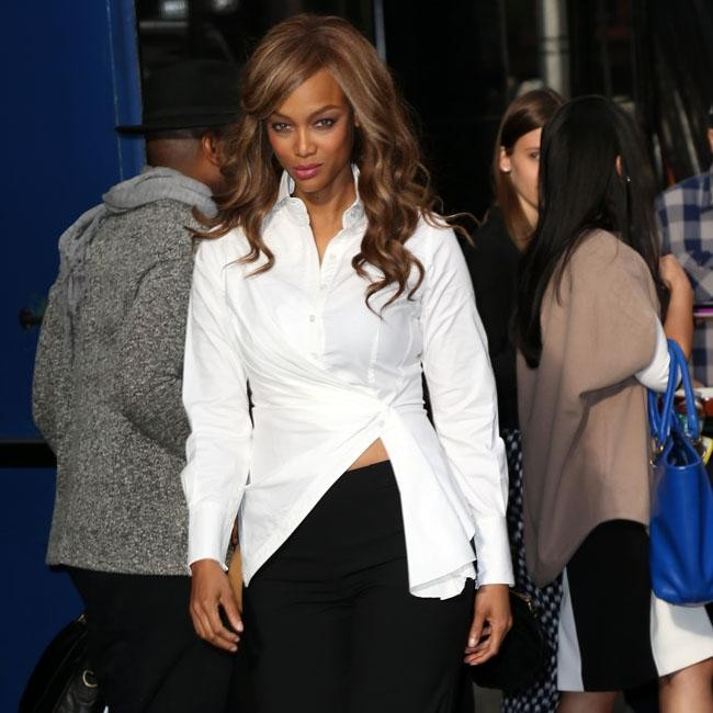 Tyra Banks Pouts For The Cameras