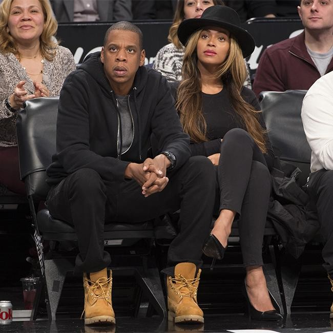 Jay Z and Beyoncé hide at basketball game