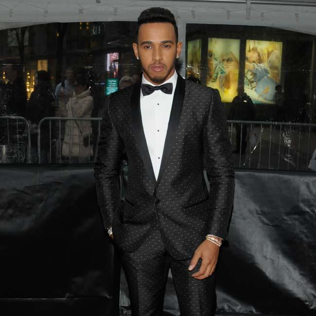 A fashionable Lewis Hamilton attends 2016 Time 100 Gala