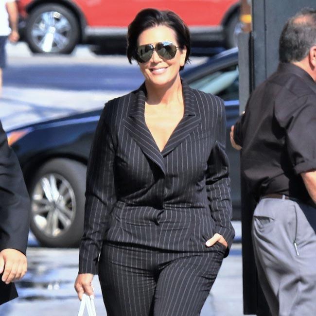Kris Jenner flashes flesh in suit jacket