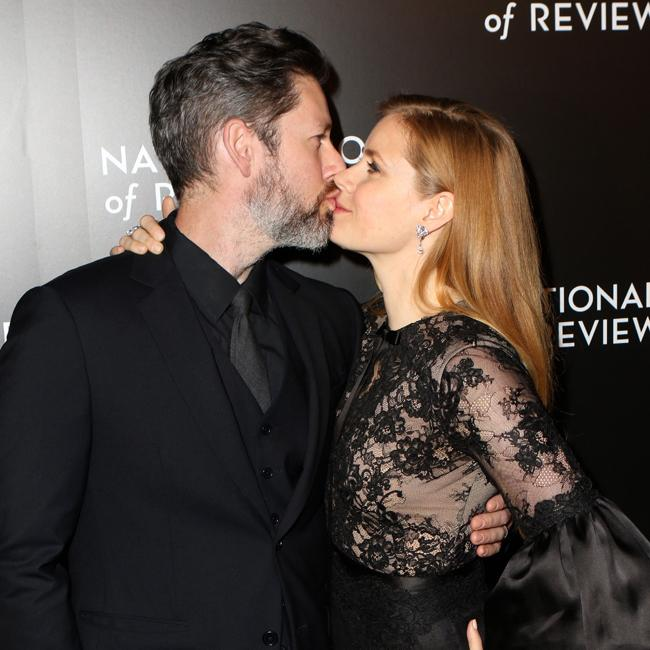 Amy Adams and Darren Le Gallo pack on the PDA