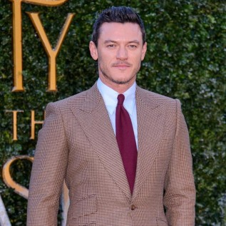 Luke Evans woos crowds at Beauty and the Beast launch