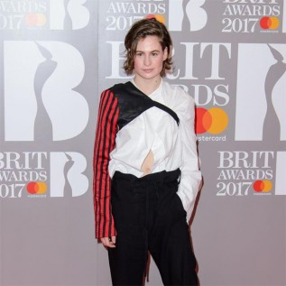 Christine and the Queens flashes her belly button on red carpet