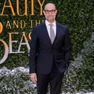 Stanley Tucci looks smug at Beauty and the Beast launch