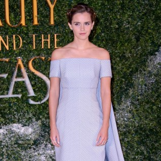 Emma Watson highlights collarbone in fetching lilac gown