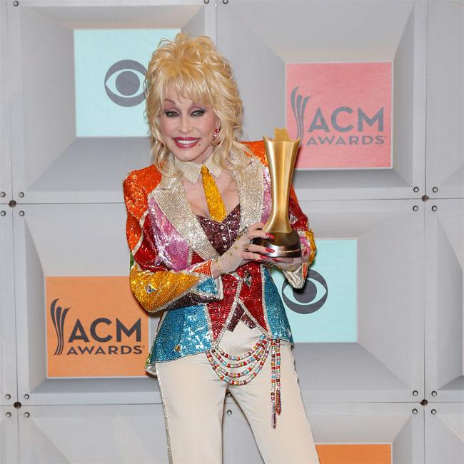 Photo Of Tennessee Firefighter Cradling Little Girl After: Dolly Parton Gives Millions To Fire Victims