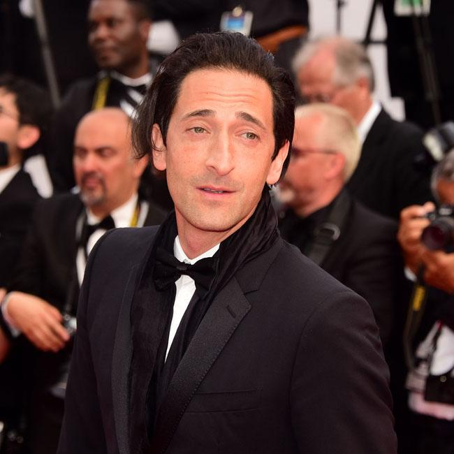 Adrien Brody is suave suited and booted
