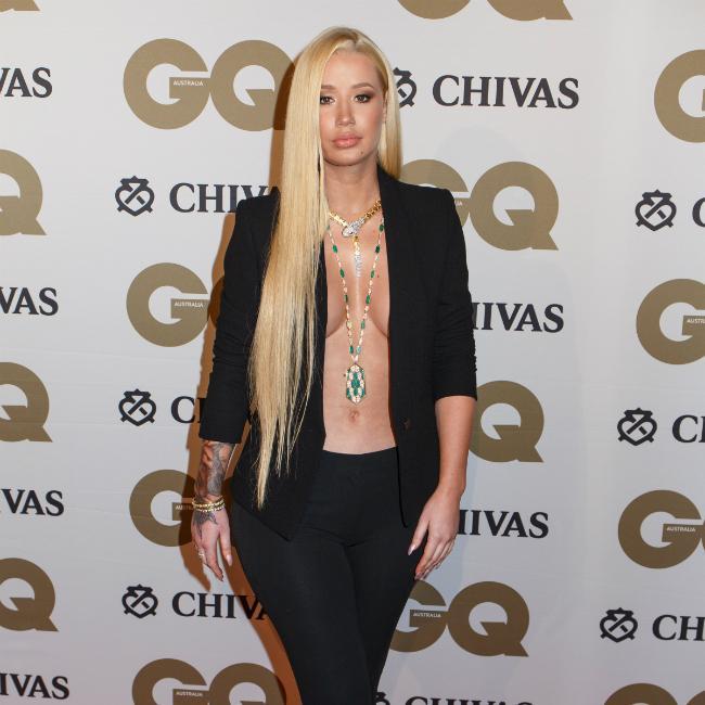 Iggy Azalea says feud with Adam Lambert is 'completely entertainment'