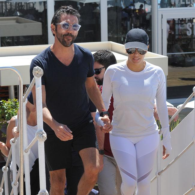 Jose Baston and Eva Longoria dress down at Cannes