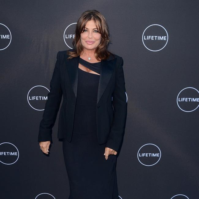 Kelly Le Brock cuts a demure look on red carpet