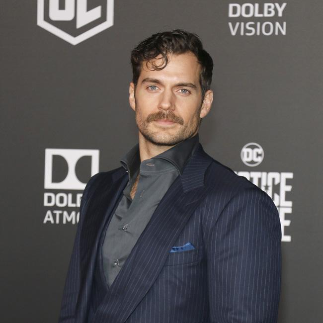 Henry Cavill looks suave at premiere