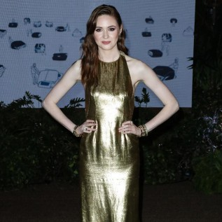 Karen Gillan dazzles in golden gown