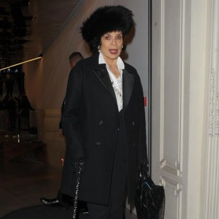 Bianca Jagger opts for a simple monochrome ensemble