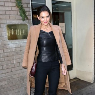 Katie Holmes' flaunts ample assets in leather top