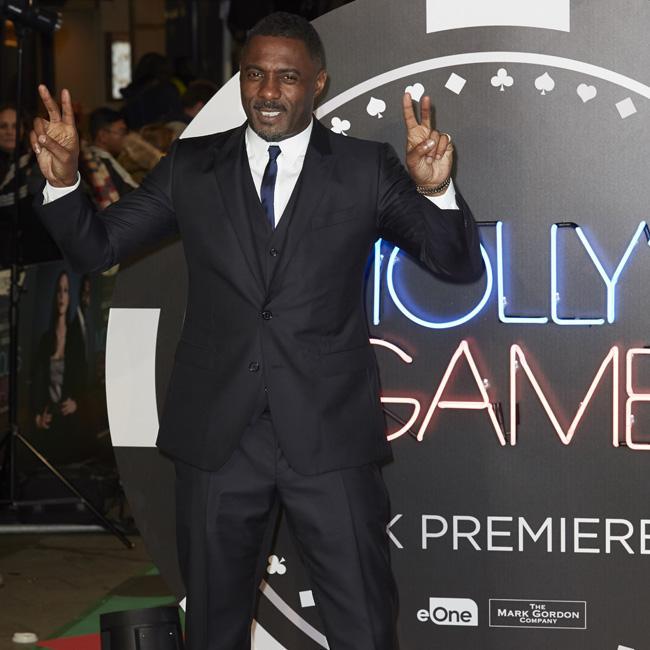 Idris Elba praises 'role model' Meghan Markle