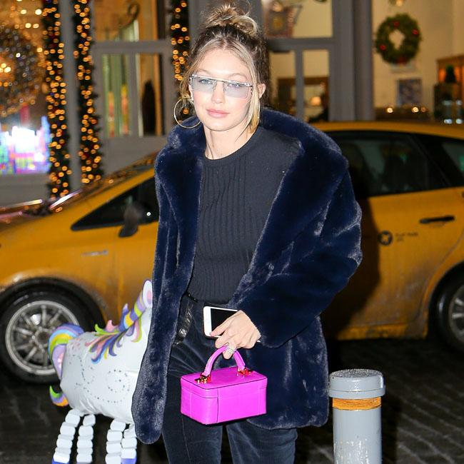 Gigi Hadid channels mom whilst holding unicorn balloon