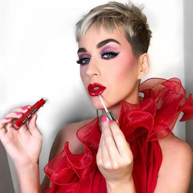 Katy Perry promotes lip gloss before Stella McCartney event