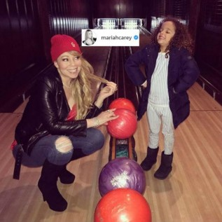 Mariah Carey goes bowling with son