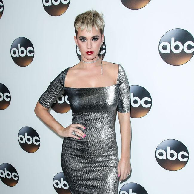 Katy Perry sparkles in shiny silver gown