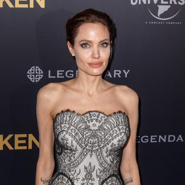 Angelina Jolie breaks collarbone snowboarding