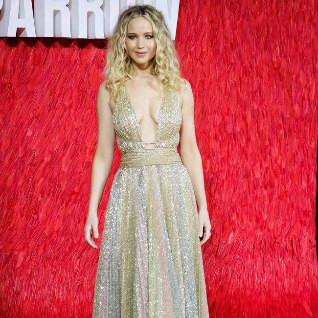Jennifer Lawrence stripped off in Kardashians' closet
