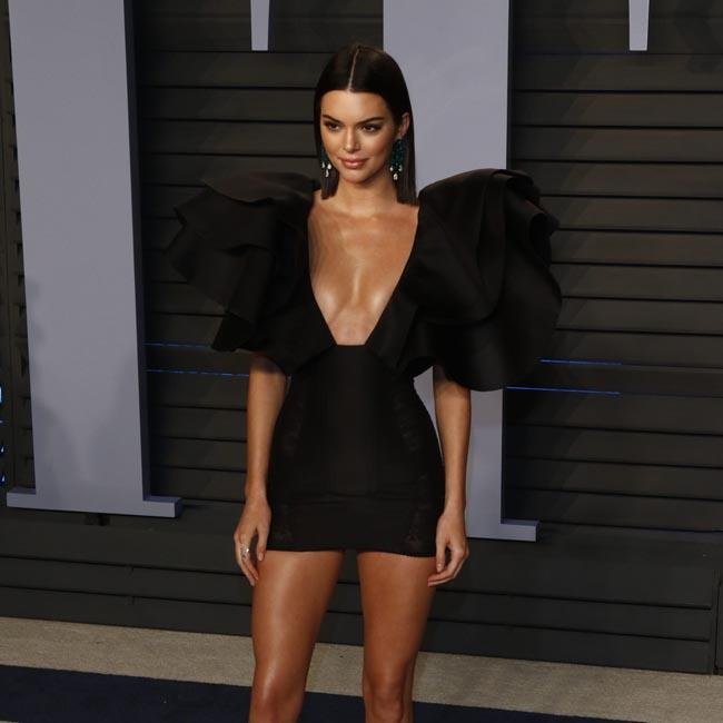 Kendall Jenner shows off her pins at the afterparty