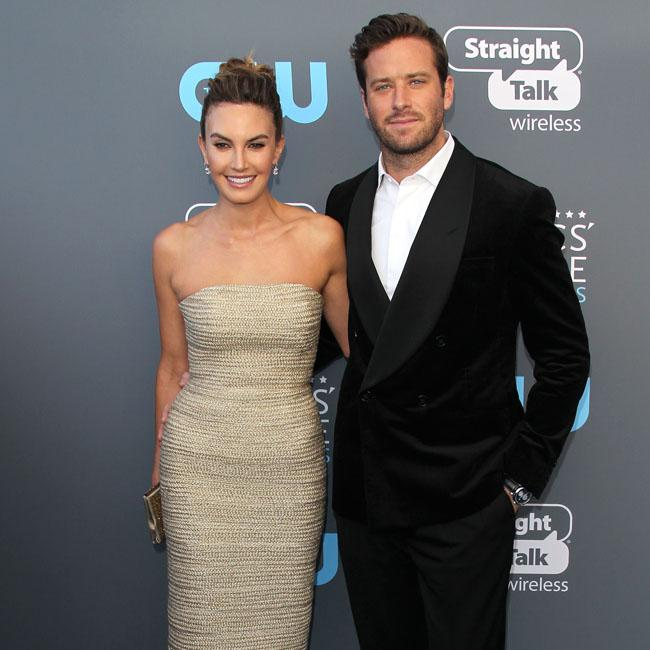 Armie Hammer's wife suing imposter