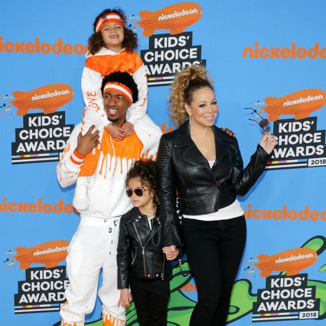Nick Cannon's twins 'love' their baby brother