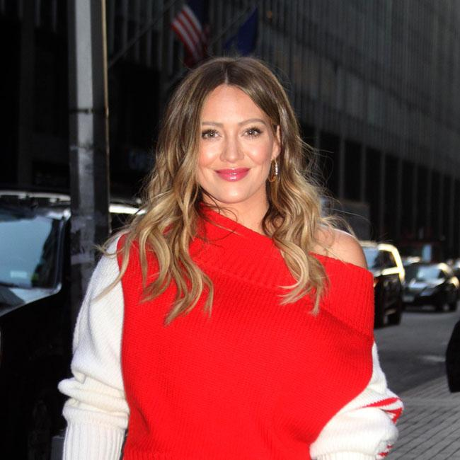 Hilary Duff rocks bright outfit to Younger premiere