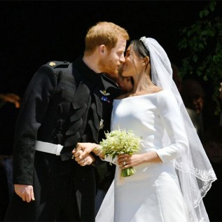 Prince Harry and Duchess Meghan's first kiss