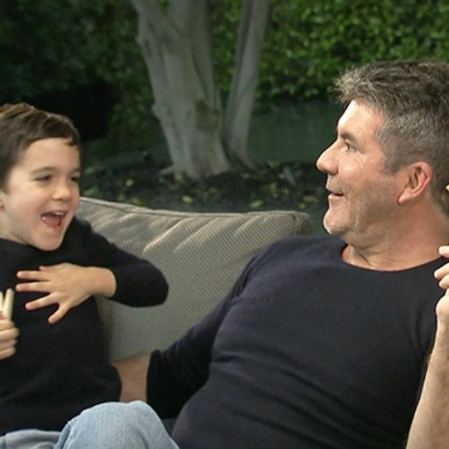 Simon Cowell tries to set son Eric up on a date