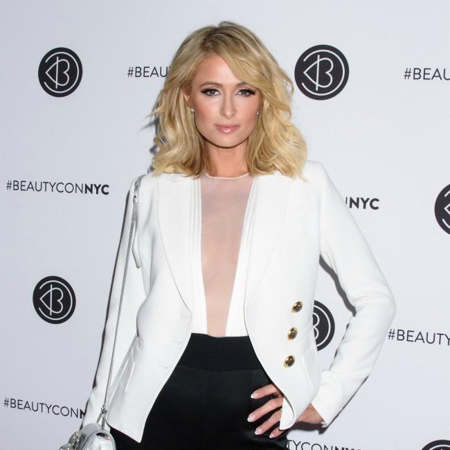 Paris Hilton continues feud with Lindsay Lohan