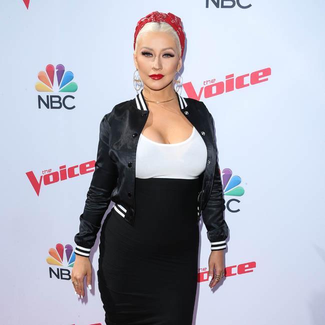 Christina Aguilera loves being a 'mama bear'