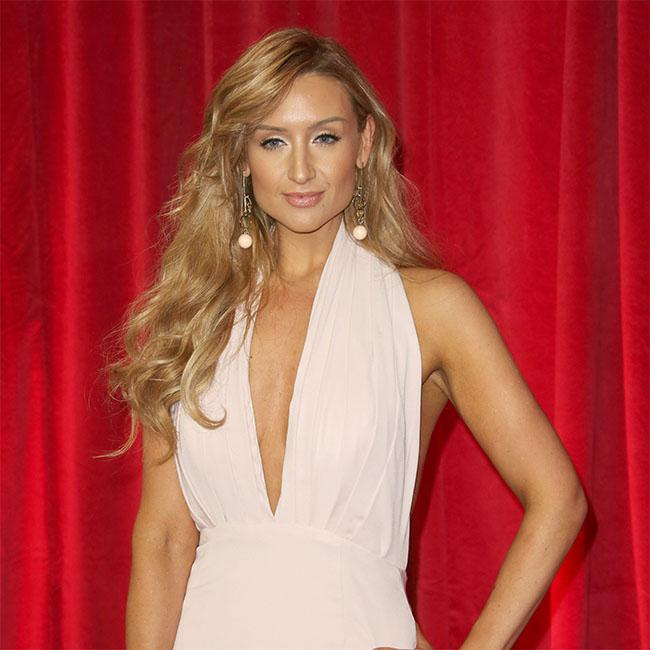 Catherine Tyldesley threatens husband with boob ban