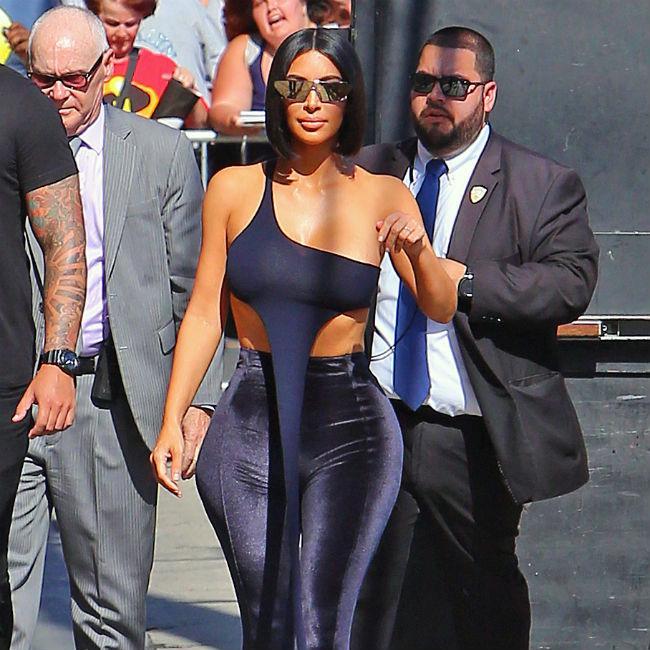 Kim Kardashian enlists help of 'selfie assistant'