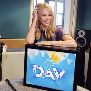 Kylie Minogue turns rail station announcer for BBC Music Day