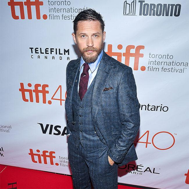 Tom Hardy guided by son