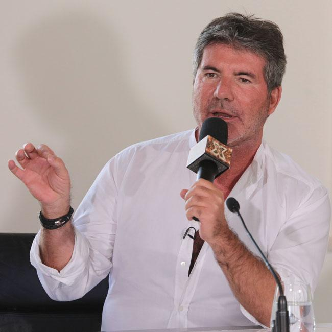 Simon Cowell misses Louis Walsh on X Factor