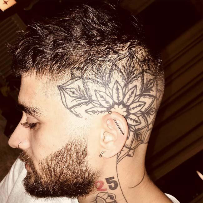 Zayn Malik shows off giant floral head tattoo