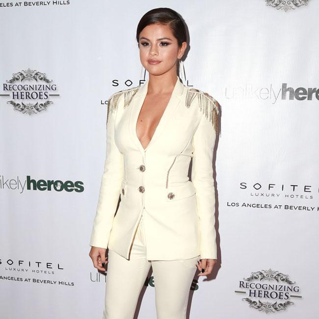 Selena Gomez 'in great spirits' before taking a break