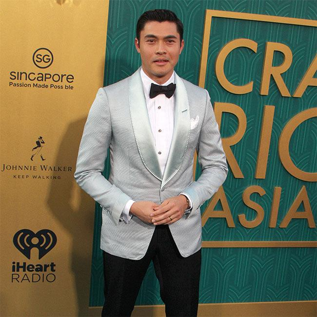 Henry Golding 'struggling' with fame