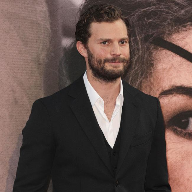 Jamie Dornan vacations with Eddie Redmayne