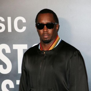 Diddy leans on Cassie for support following Kim Porter's death