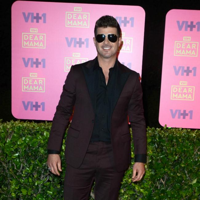 Robin Thicke's house burns down