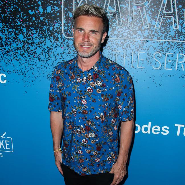 Gary Barlow insists Robbie Williams and Jason Orange won't appear on their reunion tour
