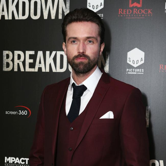 Emmett J. Scanlan slices thumb