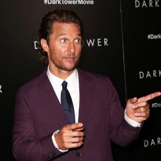 Matthew McConaughey wrestles with son