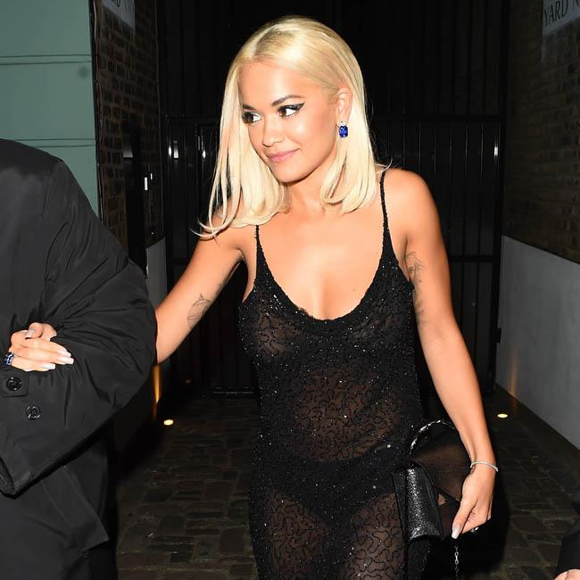 Rita Ora still does chores