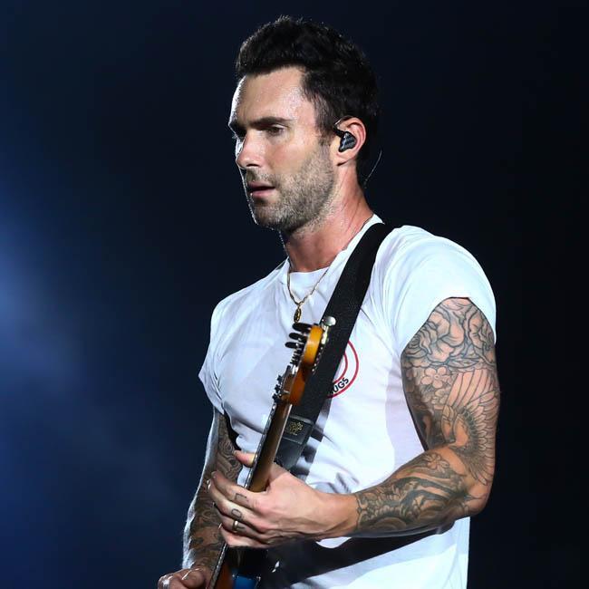 Maroon 5′s Adam Levine delivers energetic Super Bowl halftime show