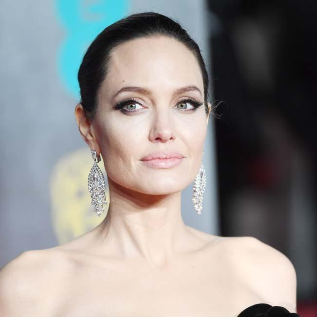 Angelina Jolie humbled by refugee camp visit